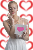 Blonde girl looks valentine postcard Royalty Free Stock Images