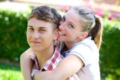 Blonde girl in love with boyfriend biting his ear Royalty Free Stock Photo