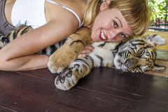 Blonde girl love tiger Royalty Free Stock Photos