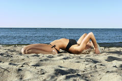 Blonde girl lying on the beach and meditate Stock Image