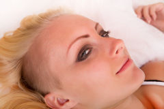 Blonde girl lying in bed Stock Photos