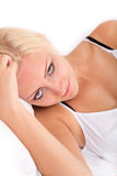 Blonde girl lying sideways in bed Royalty Free Stock Photos