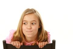 Blonde girl making a face. Little blonde girl making a face on white background Royalty Free Stock Photography