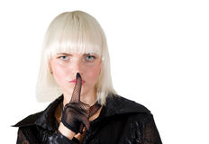 Blonde girl making a silence sign Royalty Free Stock Image