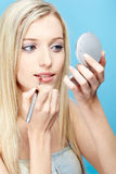Blonde girl making up Stock Photo