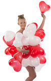 Blonde girl with many balloons on her body Royalty Free Stock Photography