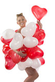 Blonde girl with many balloons on her body Stock Images