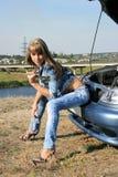 Blonde girl-mechanic Stock Photo
