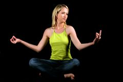 Blonde girl meditating Stock Photos