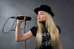 blonde girl with microphone. Beautiful young blonde girl with microphone Stock Photography