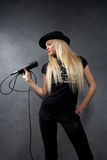 Blonde girl with microphone Stock Photography