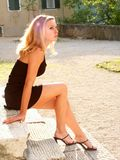 Blonde girl in miniskirt Royalty Free Stock Photo