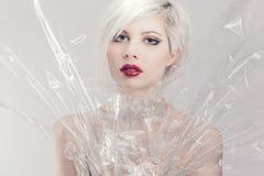 Blonde girl model in plastic Royalty Free Stock Photos