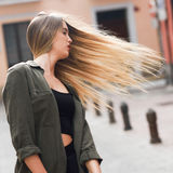 Blonde girl moving her amazing long hair Stock Images