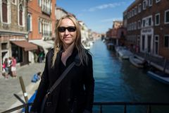 Blonde girl in Murano. Italy Stock Photos