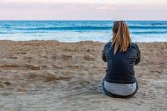 Blonde girl near the ocean Royalty Free Stock Image