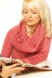 Blonde girl with newspaper. Close up stock photos