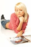 Blonde girl with newspaper. Close up royalty free stock photos