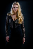 Blonde Girl On A Black Background In A Dark Guipure Dress Royalty Free Stock Photography