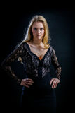 Blonde Girl On A Black Background In A Dark Guipure Dress Royalty Free Stock Photos
