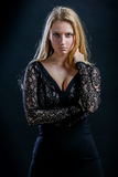 Blonde Girl On A Black Background In Dark Guipure Dress Royalty Free Stock Photo