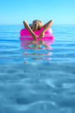 Blonde Girl On Inflatable Raft Stock Image