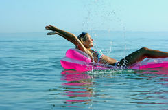 Blonde Girl On Inflatable Raft Royalty Free Stock Photos