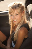 Blonde girl in open car Royalty Free Stock Photo