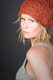 Blonde Girl in an Orange Beanie Hat Stock Photos