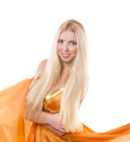 Blonde girl in orange flying dress Royalty Free Stock Images