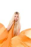 Blonde girl in orange flying dress Stock Photography