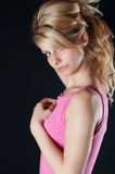 Blonde girl in pink. Blouse against black backgound stock images
