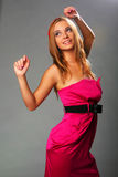 Blonde girl in a pink dress Royalty Free Stock Photos