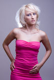 Blonde girl in pink dress Stock Image