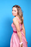A blonde girl in pink dress Stock Photo