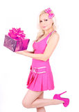 Blonde girl in pink dress holding gift box Royalty Free Stock Photo