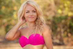 Blonde girl in pink swimming suit Royalty Free Stock Photos