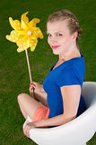 Blonde girl with a pinwheel Stock Photos