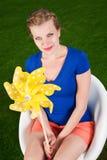 Blonde girl with a pinwheel Stock Image