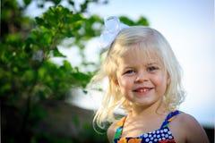 Blonde girl plaing outside stock photos