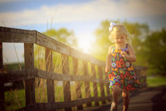 Blonde girl plaing outside royalty free stock photography