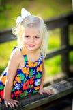 Blonde girl plaing outside stock image