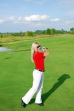 Blonde girl play golf Stock Photos
