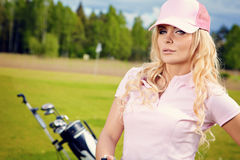 Blonde girl play golf Stock Photo