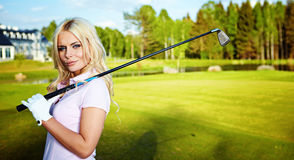 Blonde girl play golf Stock Images