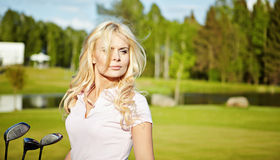 Blonde girl play golf Royalty Free Stock Images