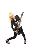 Blonde girl playing black electric guitar. Blonde girl in black lether jacket playing black electric guitar stock photo