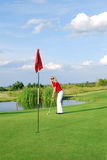 Blonde girl playing golf Stock Photo