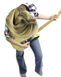 Blonde girl playing guitar in blue jeans and a plaid shirt Royalty Free Stock Image