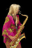 Blonde Girl Playing Saxophone Royalty Free Stock Images